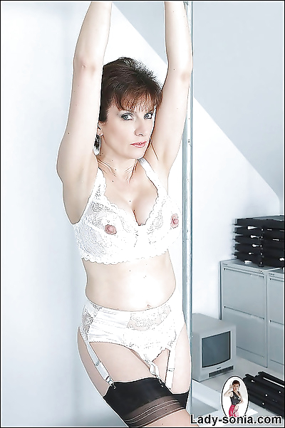 Mature babe in white..