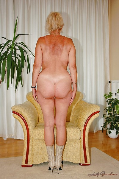 Big titted granny shows her..